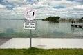 No diving sign by lake edge still reflection Royalty Free Stock Photos