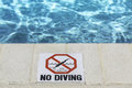 No diving sign at the poolside Stock Images