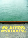 No diving or swimming stencil on concrete pier Royalty Free Stock Photos