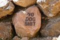 No dog s shit on rock graffiti Stock Photos