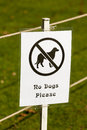 No dogs please a message or signpost saying Stock Image