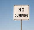 No dumping sign and blue sky Royalty Free Stock Images