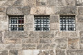 No escape image of barred windows against very old tradional brickwork Royalty Free Stock Photography