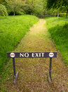 No exit barrier sign a acrosss a path through a garden Stock Photography