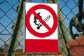 No fire red white signs on the fence Stock Images