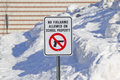 No firearms allowed on school property sign outside a in the snow Stock Photo