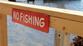 No fishing sign at boat pier in key largo florida Stock Images