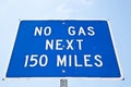 No gas miles sign on a remote road in nevada that reads Stock Photo