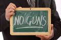 No guns message written blackboard Royalty Free Stock Image