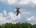 No hands or feet moto jump a freestyle rider doing a dangerous stunt at the triumph superbike races in birmingham alabama at Royalty Free Stock Photography