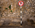 No parking european sign against rough stone wall Stock Photography