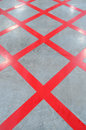 No parking red cross zone criss cross painted on polished floor lines Royalty Free Stock Image