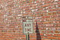 No parking sign in front of brick Royalty Free Stock Image