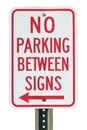 No parking sign between signs with red arrow on white metal post on white background Royalty Free Stock Photography