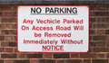 NO PARKING sign on very old brick wall - Tooting, London, UK Royalty Free Stock Photo