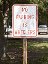 No parking wheelers sign in shade Royalty Free Stock Images