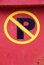 No parking yellow and black sign on red metal Royalty Free Stock Images