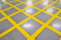 No parking yellow cross zone criss cross painted on polished fl lines floor Royalty Free Stock Image