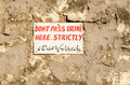 No peeing sign hand painted in english and telugu on a stone wall asking men not to pee there central hyderabad india Royalty Free Stock Images