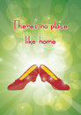 No place like home dorothys sparkly slippers on glowing emerald background Stock Image