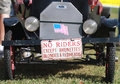 No riders except brunettes blondes and redheads small antique car with signage on the front license plate in a crowd at a car show Royalty Free Stock Image