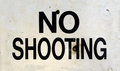 No shooting sign grungy with bullet holes Stock Image