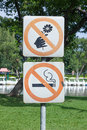 No smoking and do not pick flower metal sign in the park Royalty Free Stock Photo