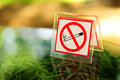 No smoking metal sign on the table Royalty Free Stock Photo