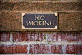 No smoking sign on brick outside of a library in oregon showing the city ordinance rules Stock Photos