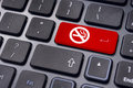 No smoking sign on keyboard for anti smoking concepts a enter key to convey in workplaces or offices Stock Photo