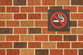 No smoking sign on multi color brick wall Royalty Free Stock Photography