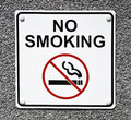 No smoking sign a white that reads in black letters Royalty Free Stock Photos