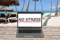 No stress text with notebook on a beach Royalty Free Stock Photo