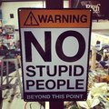 No stupid people sign beyond this point Stock Photo