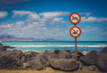 No swimming no fishing signs on the coast in corralejo fuerteventura canary islands spain Royalty Free Stock Images