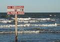 No swimming posted sign on galveston beach texas Stock Photo