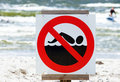 No swimming sign on beach Stock Photo