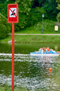 No swimming sign a danger at the beach there are distance buoy pedal boats Stock Image