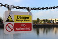 No swimming sign a deep water on a chain fence Stock Images