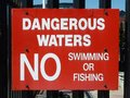 No swimming sign red about dangerous waters swiming or fishing Stock Photos