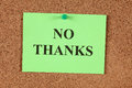 No thanks green post it note saying on corkboard bulletin board close up Royalty Free Stock Photos