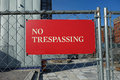 No trespassing a red sign on a fence Royalty Free Stock Images