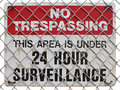 No trespassing sign on the fence warning about surveillance Royalty Free Stock Photos