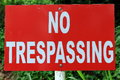 No trespassing sign a on white pole Stock Image