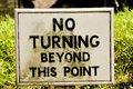 No turning beyond this point sign on a wooden stake Stock Photos