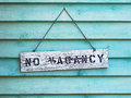 No vacancy on aqua sign hanging blue or painted cedar siding Stock Image