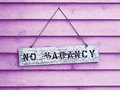 No vacancy on pink sign hanging painted cedar siding Stock Image