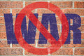 No war sign painted on old red brick wall surface as a antimilitarism concept Royalty Free Stock Image