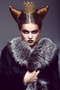Nobility honorable princess with golden crown creative concept strict woman gold creativity Royalty Free Stock Photo
