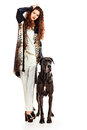 Noble couple beautiful young woman posing with her great dane dog isolated over white Royalty Free Stock Photos